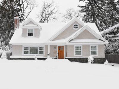 Winter Snow Craftman Cape Cod Style Home